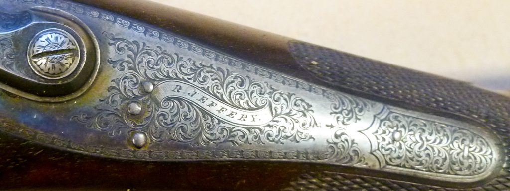 Fine engraving with the devil between the hammers and the explosion motif at the pinfire pin holes.